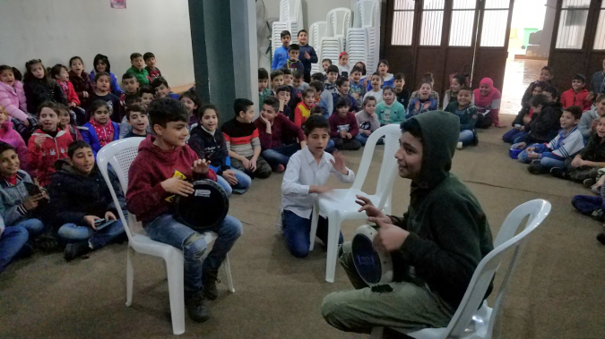 Syrian refugee students perform a song for their teachers at Horizons' School of Hope