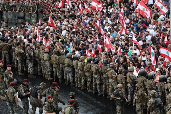 Protestors confront Lebanese Military during the Protests.